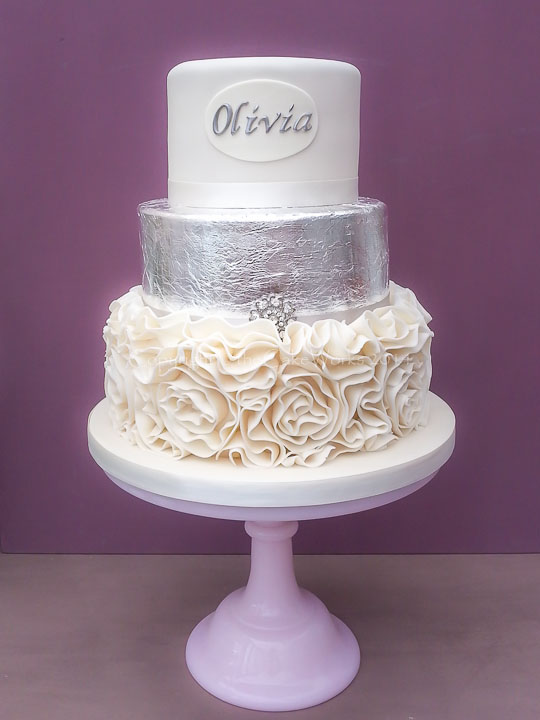Silver leaf and scroll icing cake in three tiers.